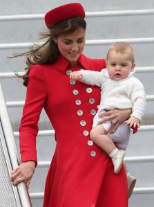 Prince-George-and-the-Duchess-of-Cambridge-arrive-in-New-Zealand-red-outfit-and-hat-2014